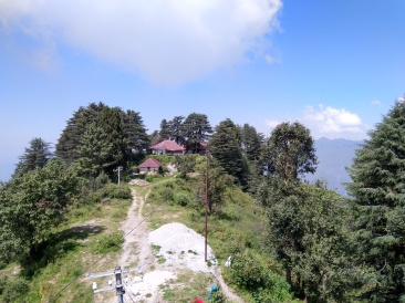 An old cottage at the edge of a cliff at Lal tibba overlooking the valley and the Himalayas.